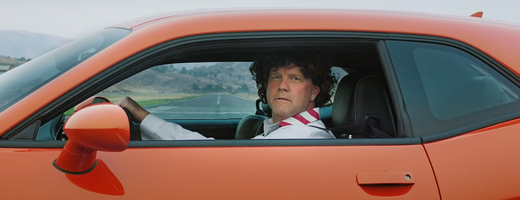 Dodge Family Motto Talladega Nights commercial still of stunt driver in Dodge Challenger model