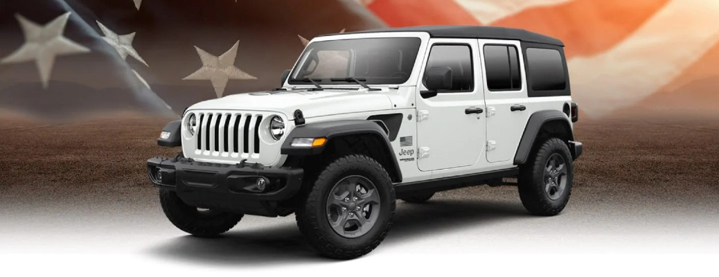 2021 Jeep Wrangler Freedom Edition exterior promo shot with white paint color and American flag background