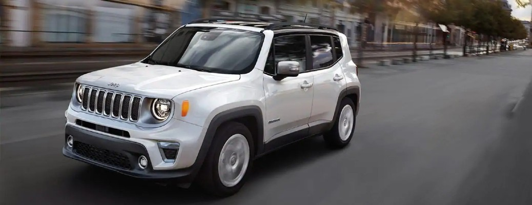 The front and side view of a white 2021 Jeep Renegade.