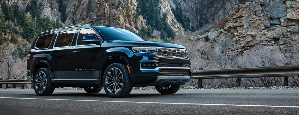 The front and side view of a black 2022 Jeep Wagoneer.