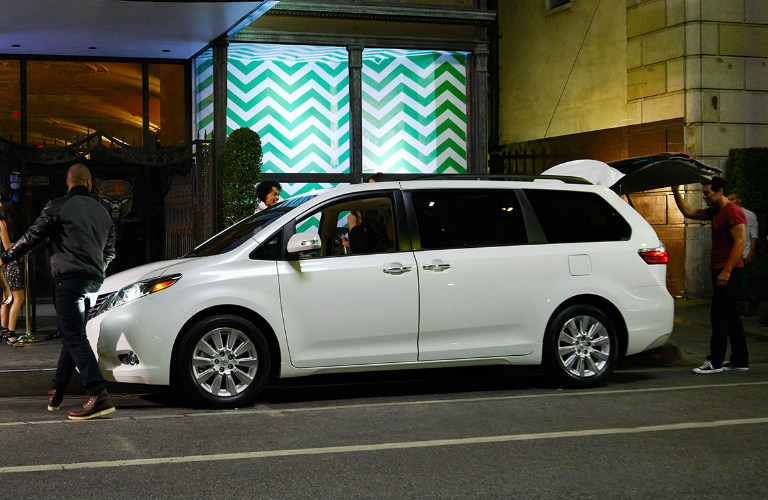 white Toyota Sienna parked at night