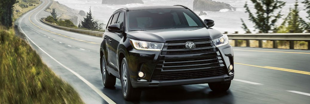 2017 Toyota Highlander in black driving.