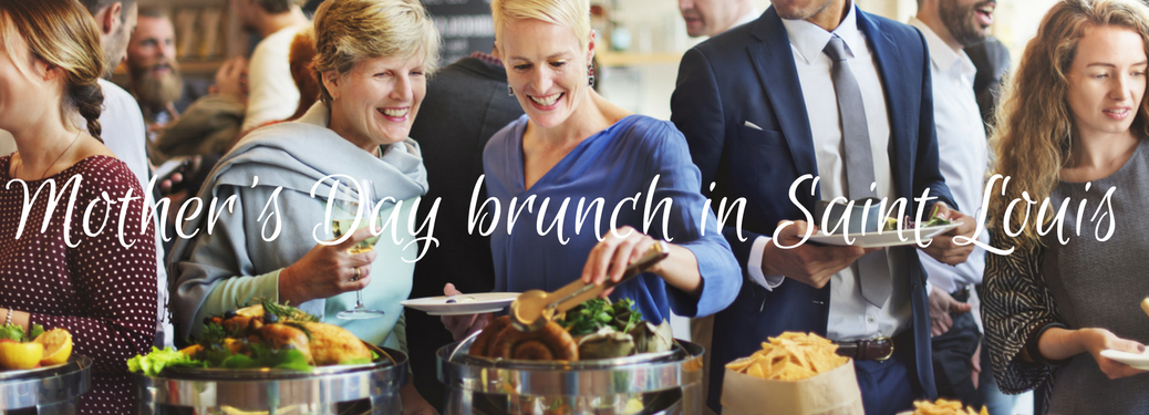 two women sorrounded by others enjoy a brunch buffet