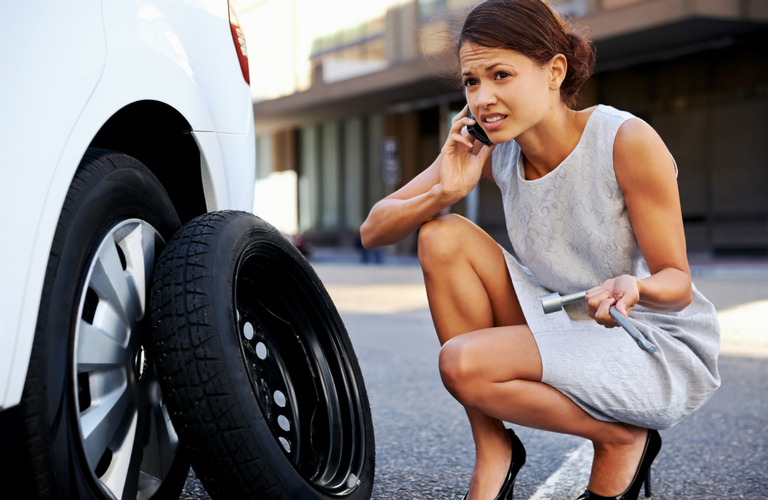 Woman calls for flat tire assistance