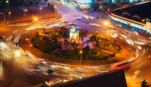 roundabout with traffic at night