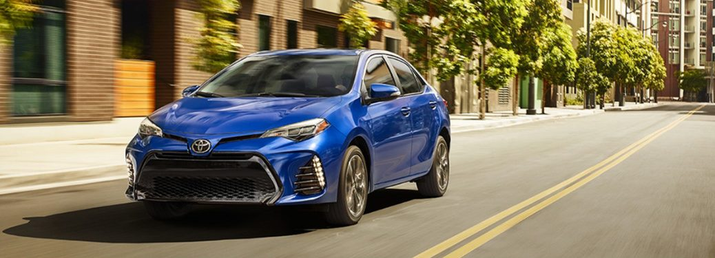 2018 Toyota Corolla in a bold blue driving down a city street