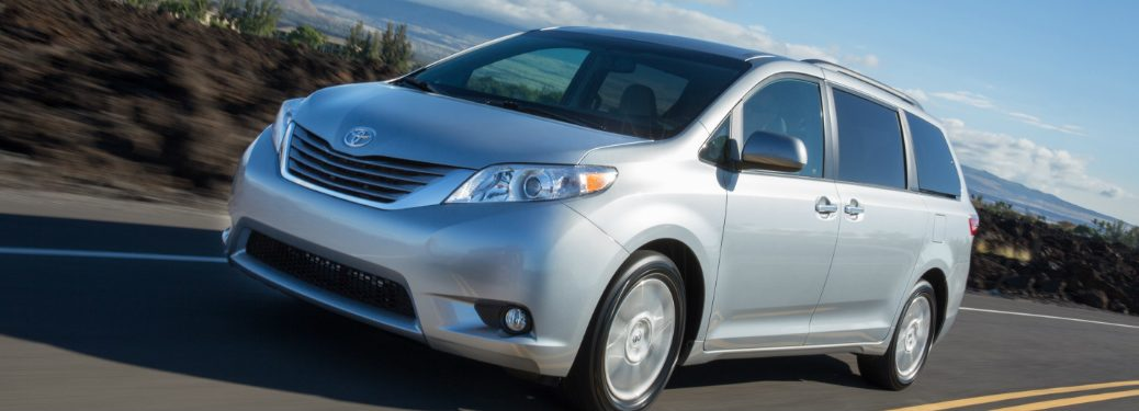2017 Toyota Sienna van in silver driving down a blurred street