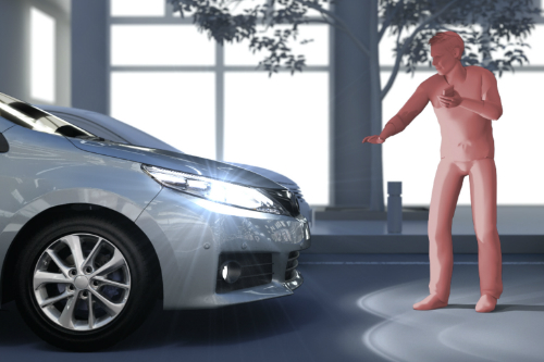 Pink figure standing in front of a Toyota with its hand outstretched