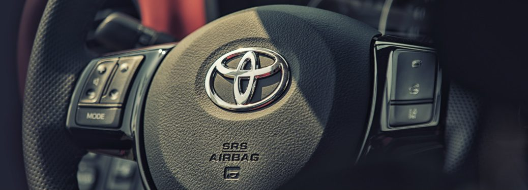 Close up of a Toyota steering wheel
