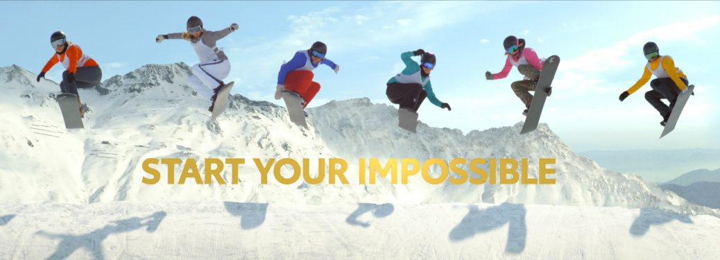 Toyota commercial still featuring 6 snowboarders in the air with the words start your impossible