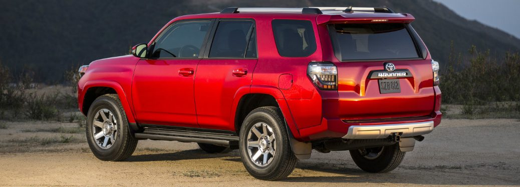 2018 Toyota 4Runner in red parked on a nature path