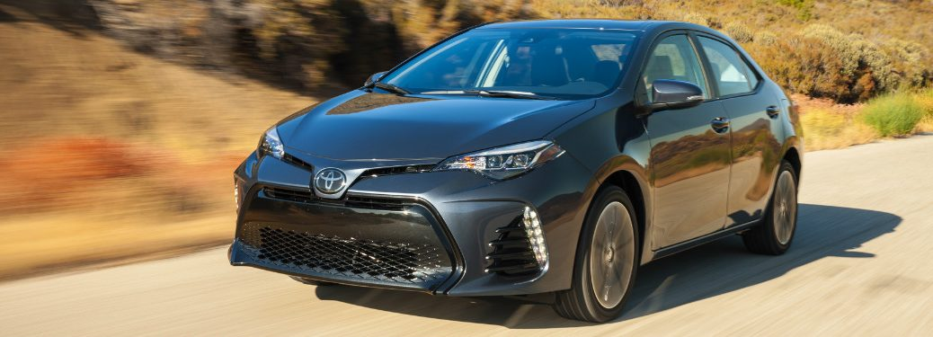 2018 Toyota Corolla in gray driving down a desert road