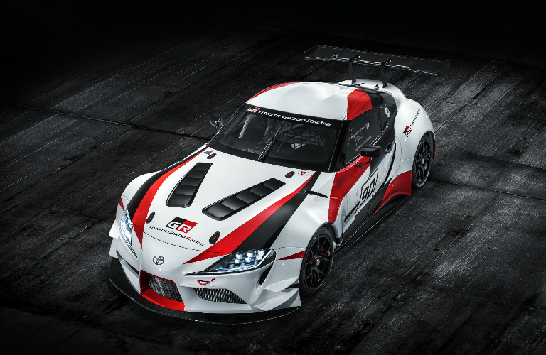 Toyota GR Supra Racing concept exterior in white with black and red accents