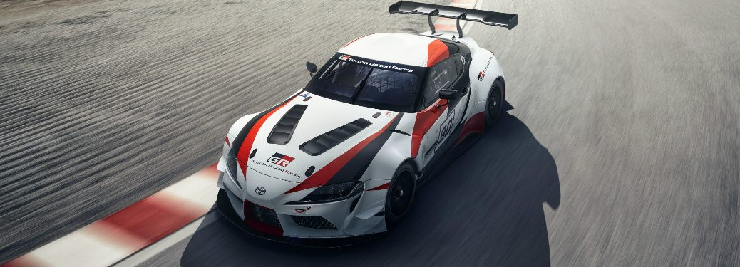Toyota GR Supra Racing concept driving on a race track