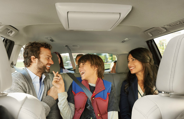 Passengers sitting in the rear seats of the 2018 Toyota Highlander