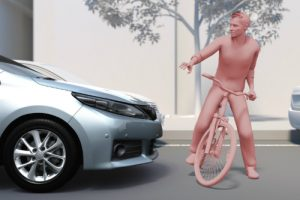 Graphic of a Toyota vehicle pausing for a man on a bicycle