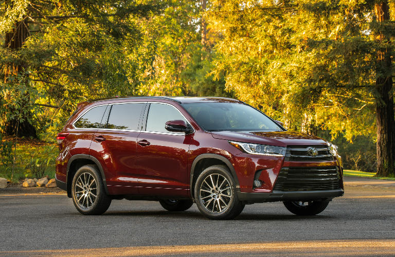 2018 Toyota Highlander in red parked on an empty street