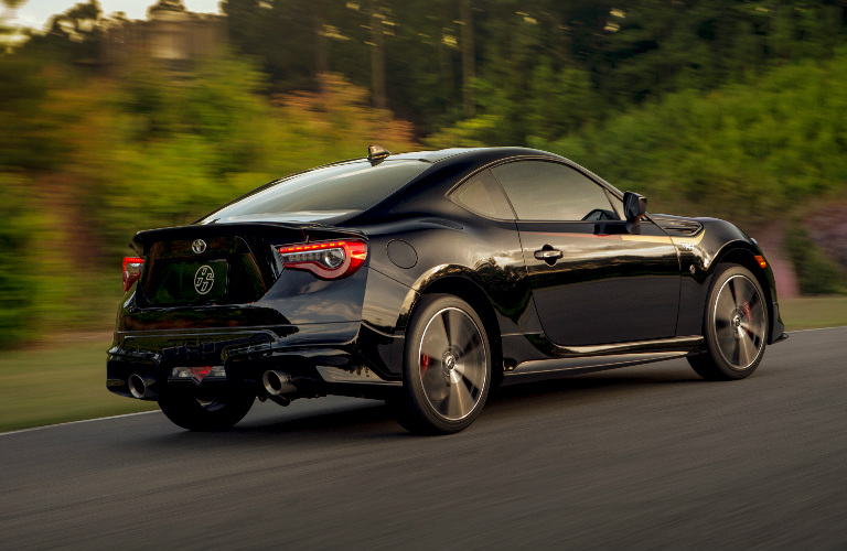 2019 Toyota 86 in black driving on a country road