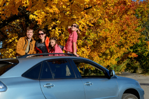 Family on a car trip in fall