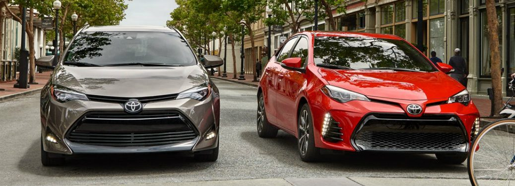Two 2019 Toyota Corolla models stopped at a crosswalk