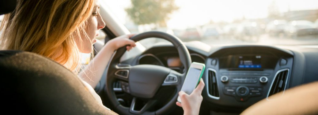 Someone driving while texting