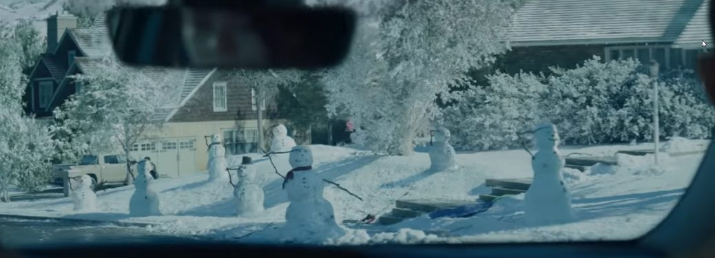 Still from the 2018 Toyotathon Hone for the Holidays commercial with snowmen saluting