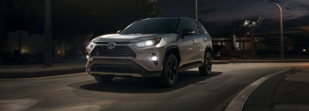 2019 Toyota RAV4 driving on an empty street at night