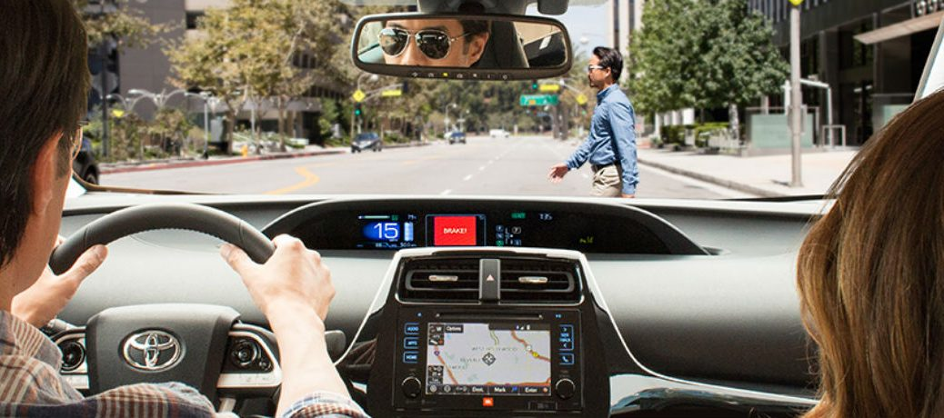 Toyota drivers alerted about a pedestrian via Toyota Safety Sense on their dashboard