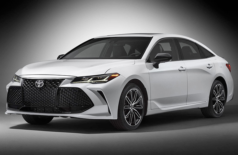 White 2019 Toyota Avalon on a grey background