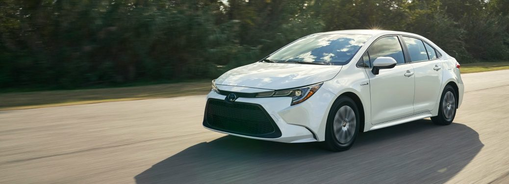 2020 Toyota Corolla in white driving down a country road