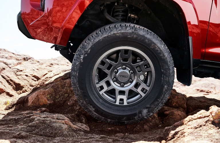 2020 Toyota 4Runner Venture Edition tire going over rock