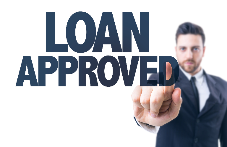 Business Man Pointing at Loan Approved Words