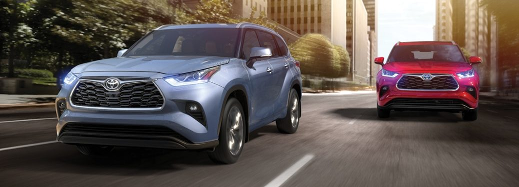 2020 Toyota Highlander vehicles going down the street