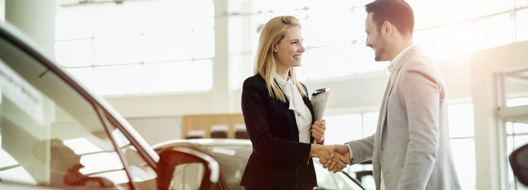 Business woman and man shaking hands