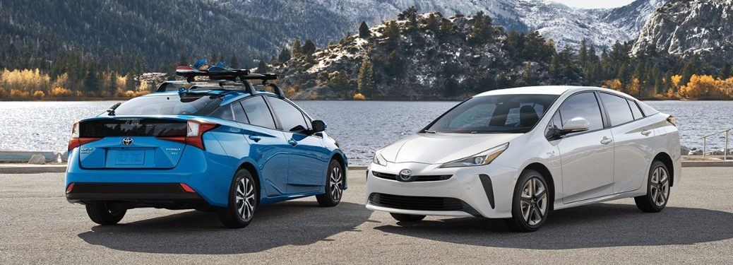 2020 Toyota Prius models parked next to a lake