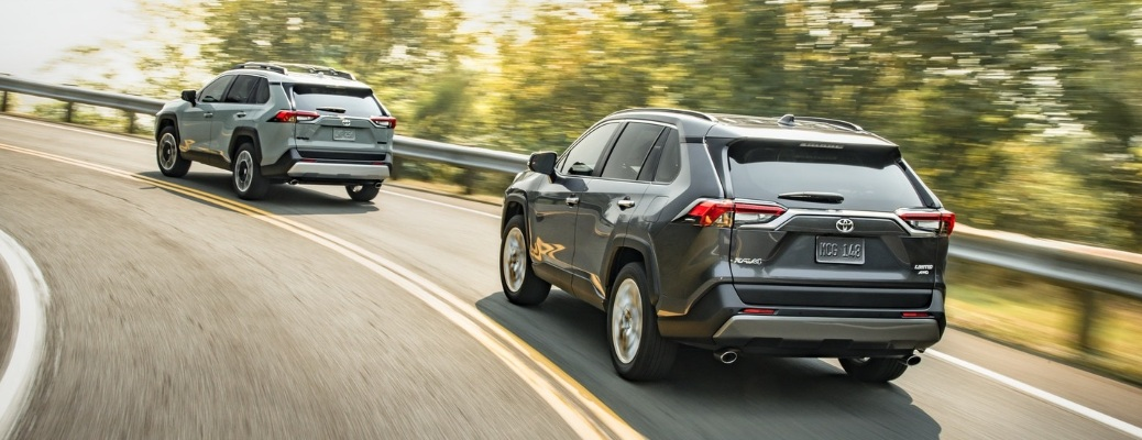 Two 2020 Toyota RAV4 crossovers driving away