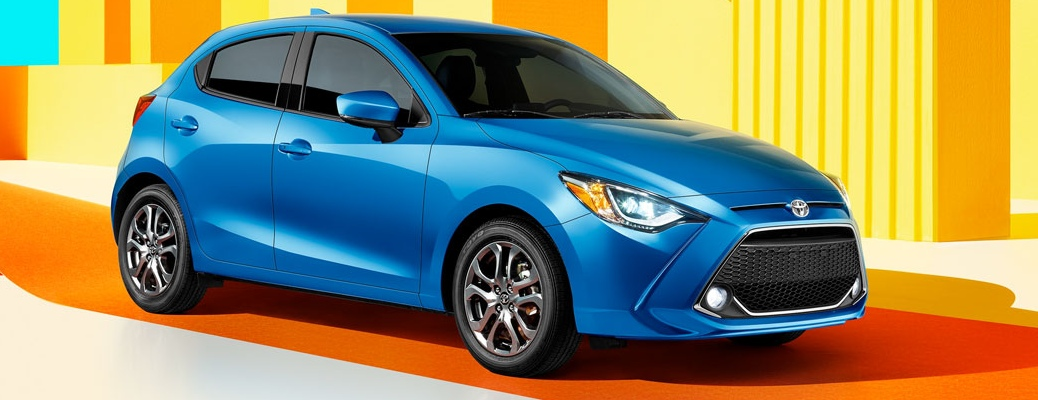 2020 Toyota Yaris Hatchback with wild colors in the background