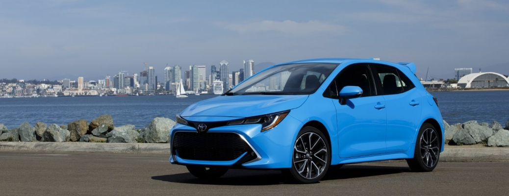 2021 Toyota Corolla Hatchback with water and city in the background