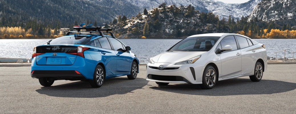 Two 2020 Toyota Prius vehicles parked next to water