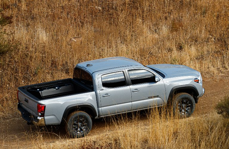 2021 Toyota Tacoma Trail Edition going through a field