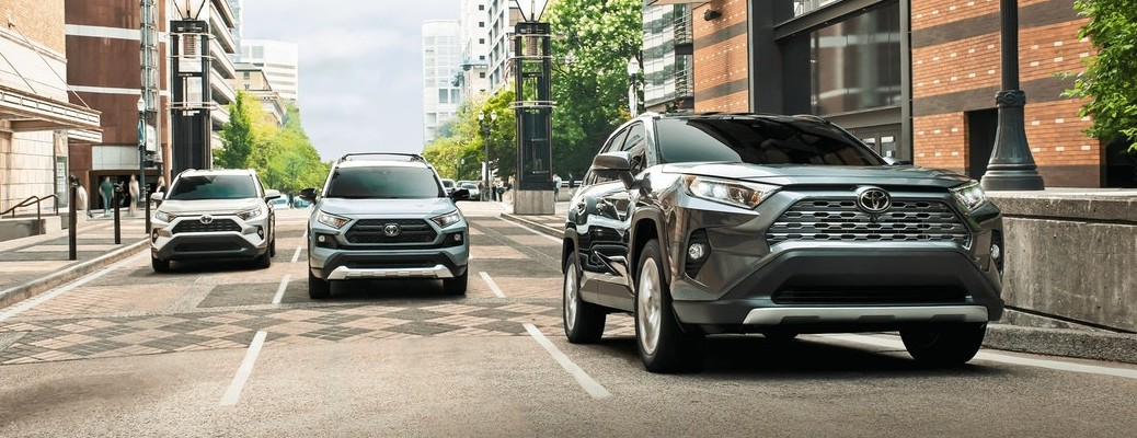 Three 2021 Toyota RAV4 Hybrids going down the road