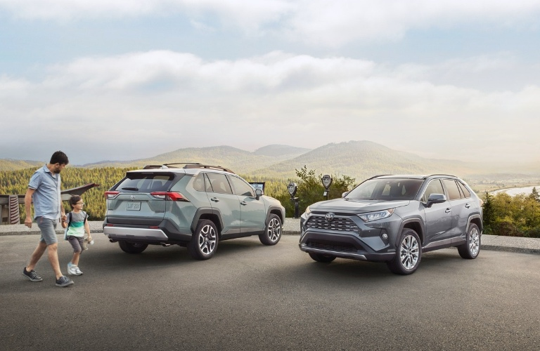 Two 2021 Toyota RAV4 Hybrids parked next to each other
