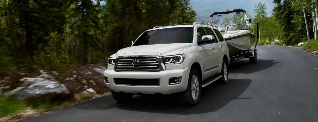 2021 Toyota Sequoia pulling a boat down the road