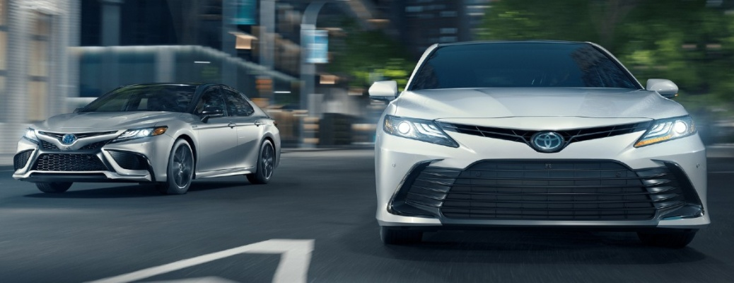 Two 2021 Toyota Camry sedans going down the road