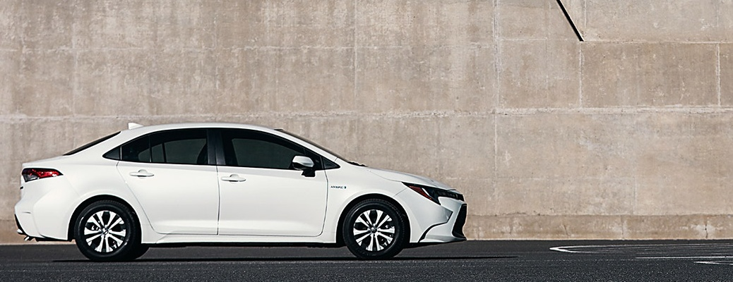 2021 Toyota Corolla Hybrid in front of a concrete wall
