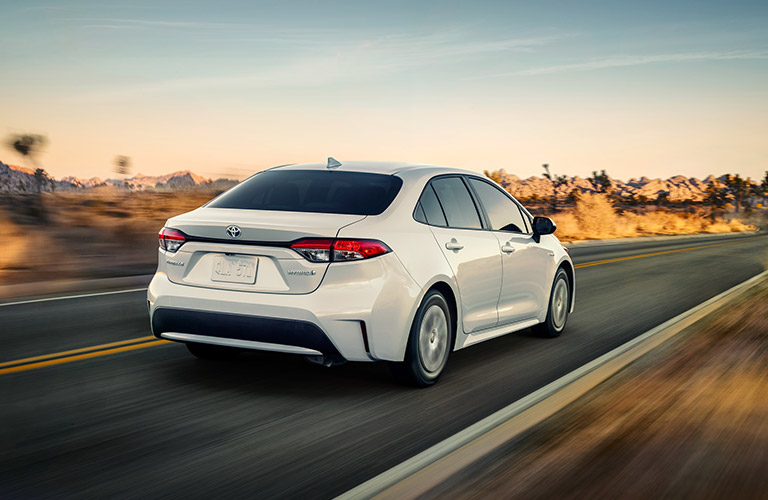 2021 Toyota Corolla Hybrid driving into the sunset