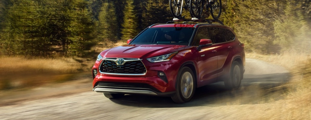 2021 Toyota Highlander Hybrid going down the road