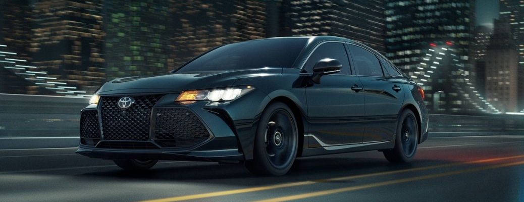 2021 Toyota Avalon with city lights in the background