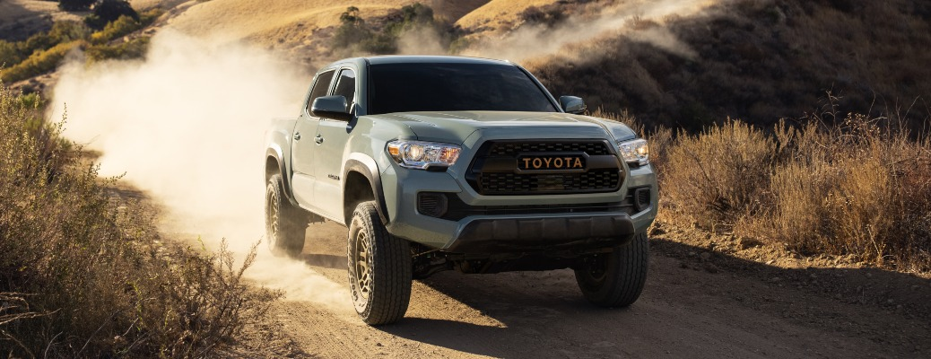 2022 Toyota Tacoma gray front view on a desert trail