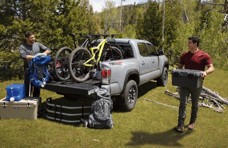 2021 Toyota Tacoma being loaded up by two men